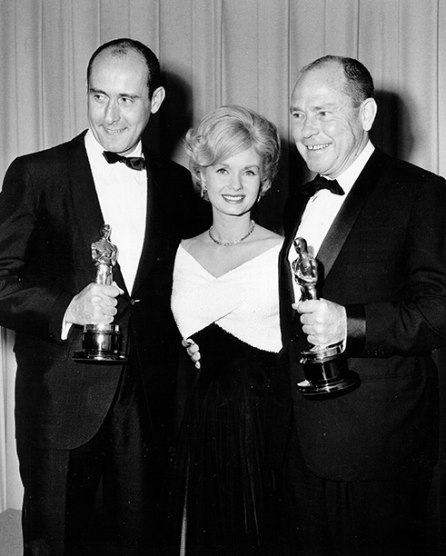 Debbie Reynolds With Henry Mancini and Johnny Mercer at the Oscars on April 8, 1963