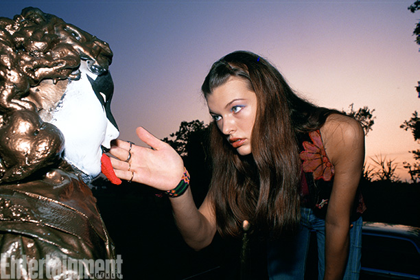 Dazed And Confused | Milla Jovovich gets the Gene Simmons tongue just right as she covers the soldier statues in KISS makeup.