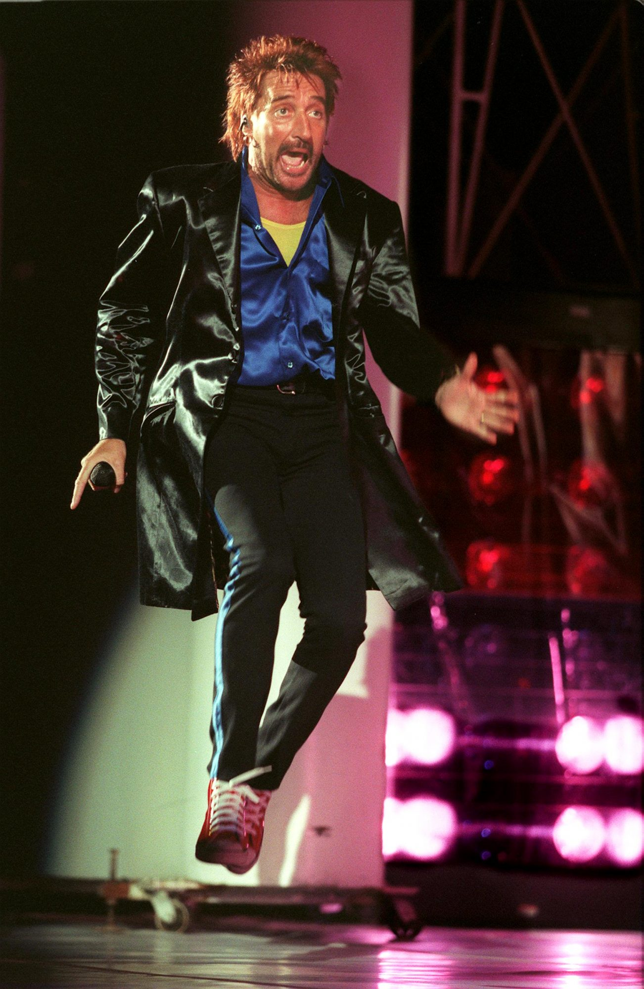 Rod Stewart performs in concert at the Hollywood Bowl in Hollywood. Stewart has been performing for