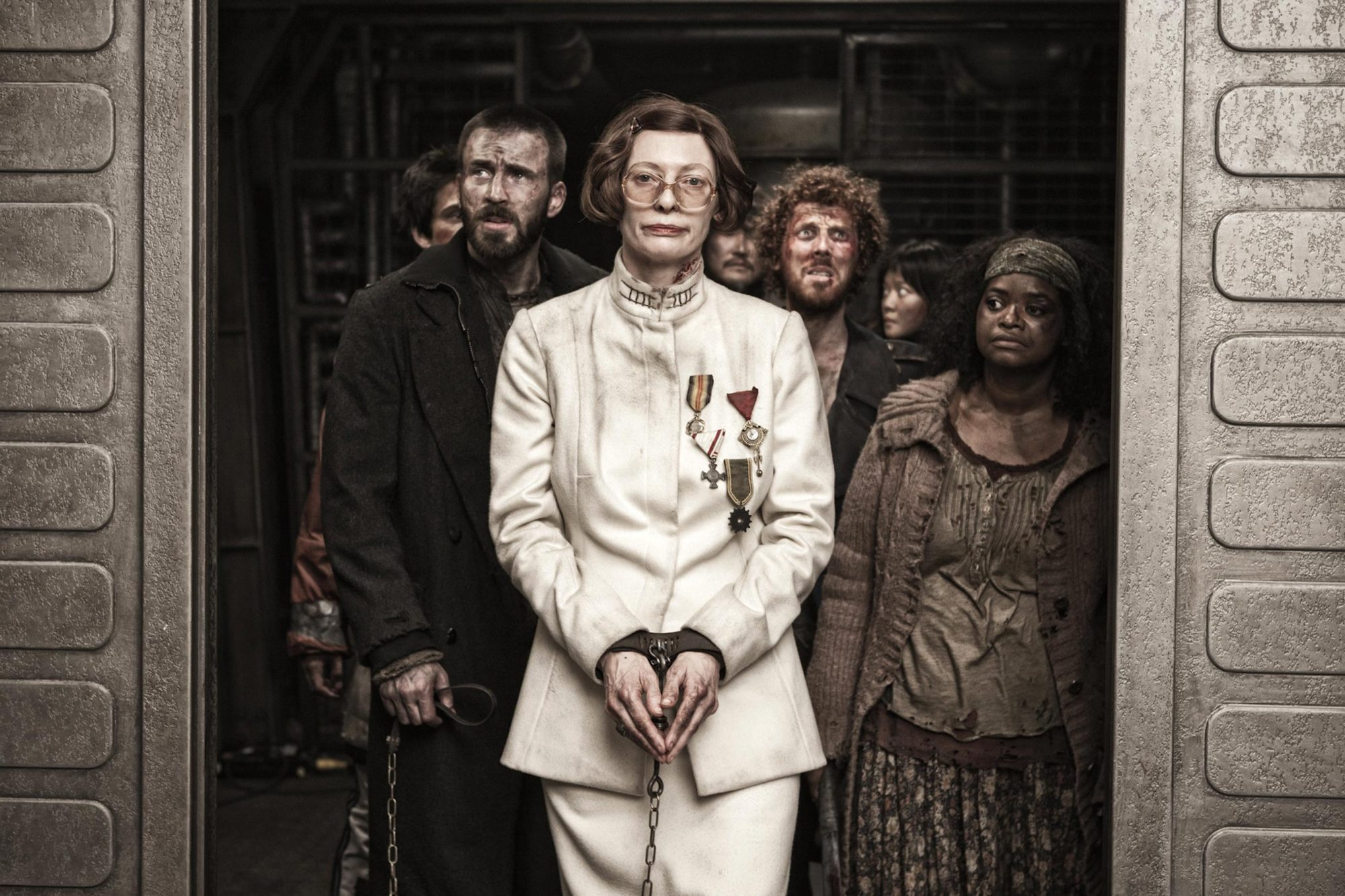 Snowpiercer (2014)Chris Evans (L), Tilda Swinton (center), Octavia Spencer (R)