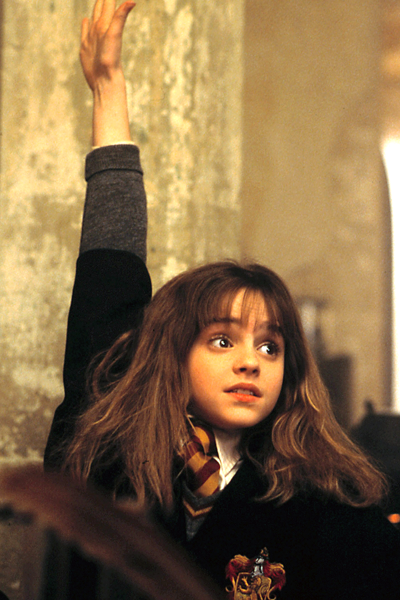 HARRY POTTER AND THE SORCERER'S STONE, Emma Watson as Hermione Granger, in class at Hogwarts, 2001