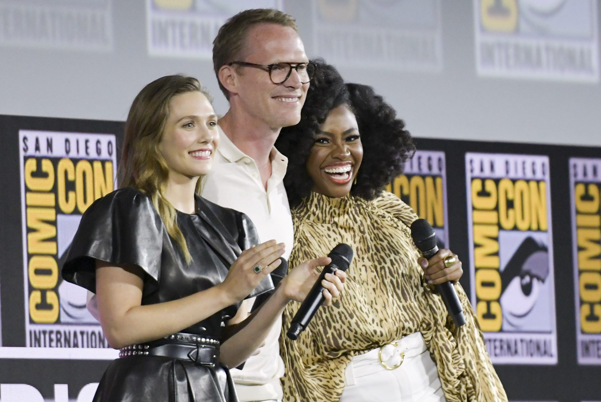 (FromL) US actress Elizabeth Olsen, English-US actor Paul Bethany and US actress Teyonah Parris speak on stage for the Marvel panel in Hall H of the Convention Center during Comic Con in San Diego, California on July 20, 2019. (Photo by Chris Delmas / AFP) (Photo credit should read CHRIS DELMAS/AFP/Getty Images)