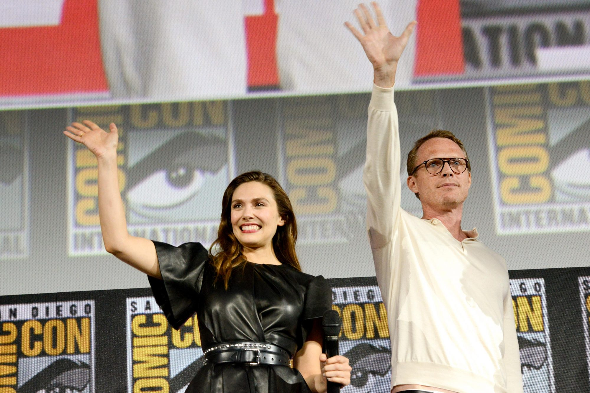 SAN DIEGO, CALIFORNIA - JULY 20: Elizabeth Olsen and Paul Bettany speak at the Marvel Studios Panel during 2019 Comic-Con International at San Diego Convention Center on July 20, 2019 in San Diego, California. (Photo by Albert L. Ortega/Getty Images)