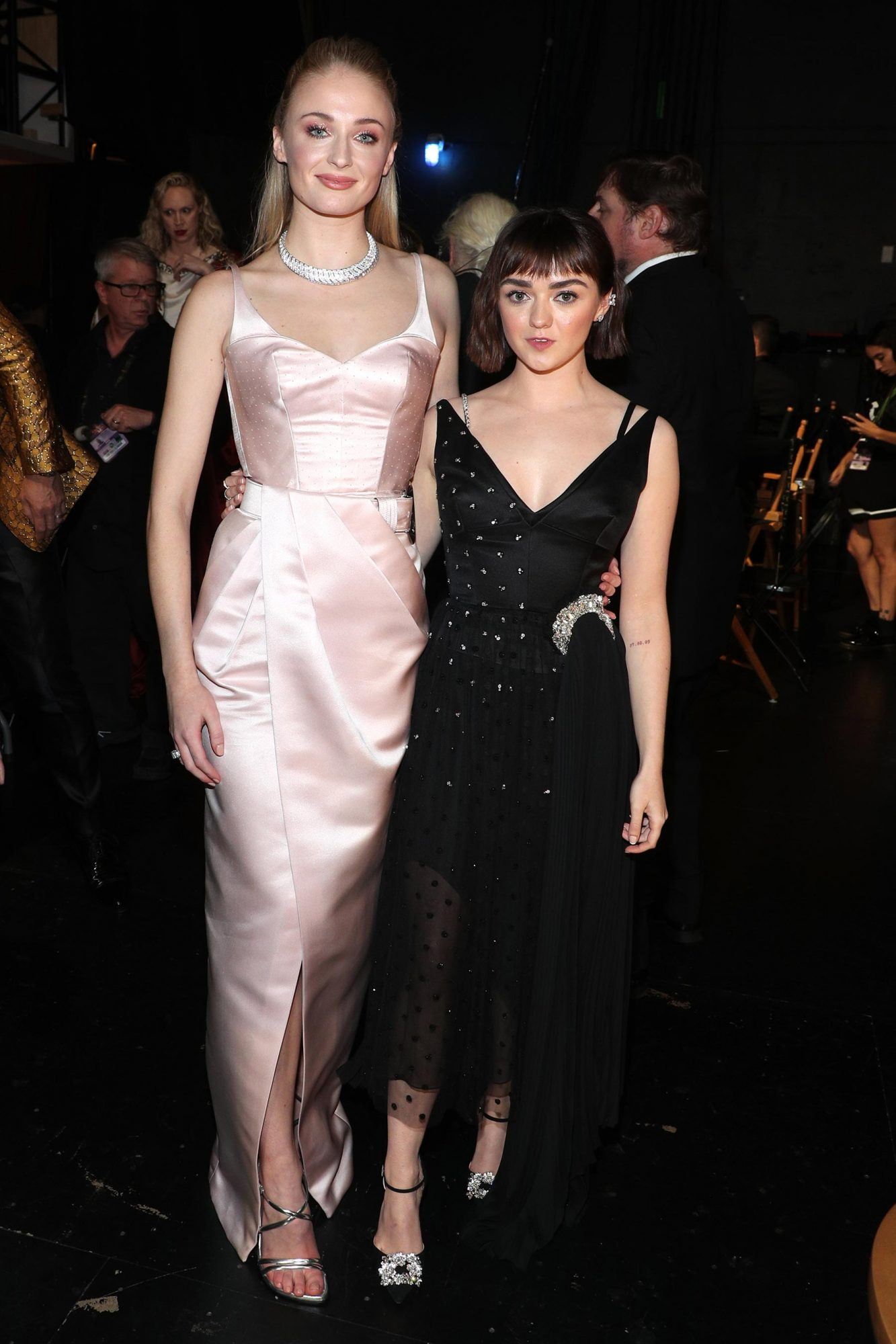 ophie Turner (L) and Maisie Williams