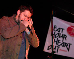 Chef Will Gilson of Garden at the Cellar playing harmonica at last year's event.