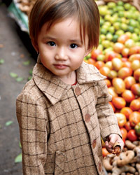 Laos Food Journey: Child at the Produce Market