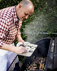 CSA Farm: Chef James Holmes grills oysters.