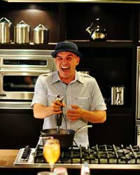 Michael Symon Cracking Up While Immersion Blending