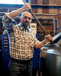Giuseppe Tentori stirs the mash.