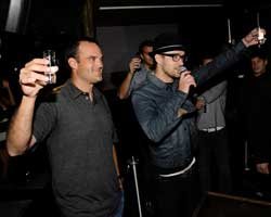 Justin Timberlake raises a glass of his new 901 Silver Tequila.