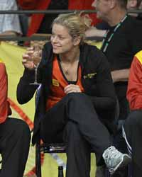 Tennis star Kim Clijsters with wine on the sidelines.