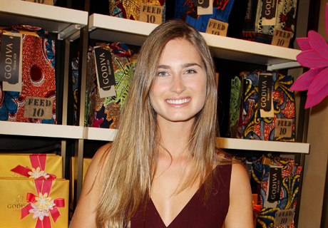 Lauren Bush with her fabulous new Godiva Feed 10 bag.