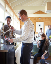 Wine on Tap: Jordan Kivelstadt works the kegerator.