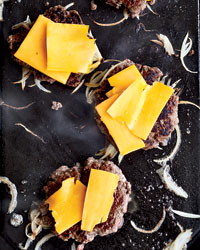 Making Smashed Burgers: Top with Cheddar