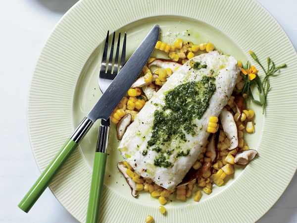 To quickly add flavor to halibut, fold chives and tarragon into softened butter, wrap in foil, and grill until done. // © Ryan Liebe