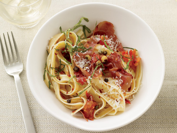 Fried capers add a delectable salty crunch to this pasta tossed with fresh tomatoes and prosciutto.