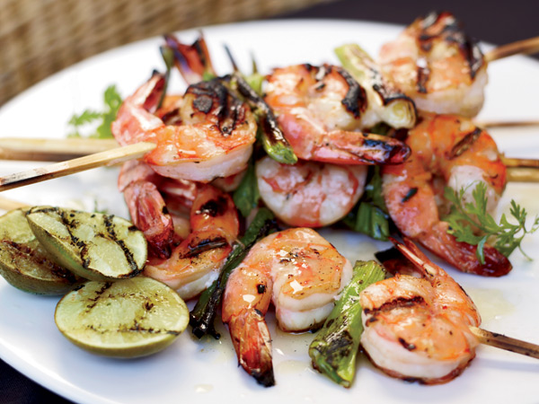 Double the recipe for these grilled shrimp skewers for a fantastic shrimp salad the next day. / © Con Poulos
