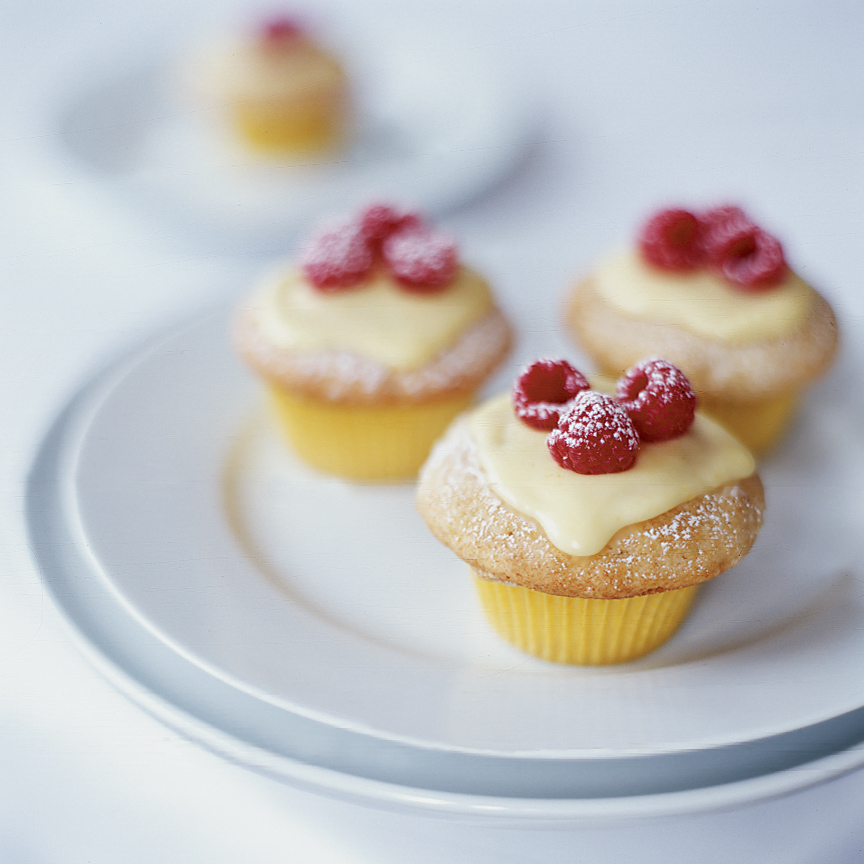 Vanilla Cupcakes with Lemon Cream and Raspberries
