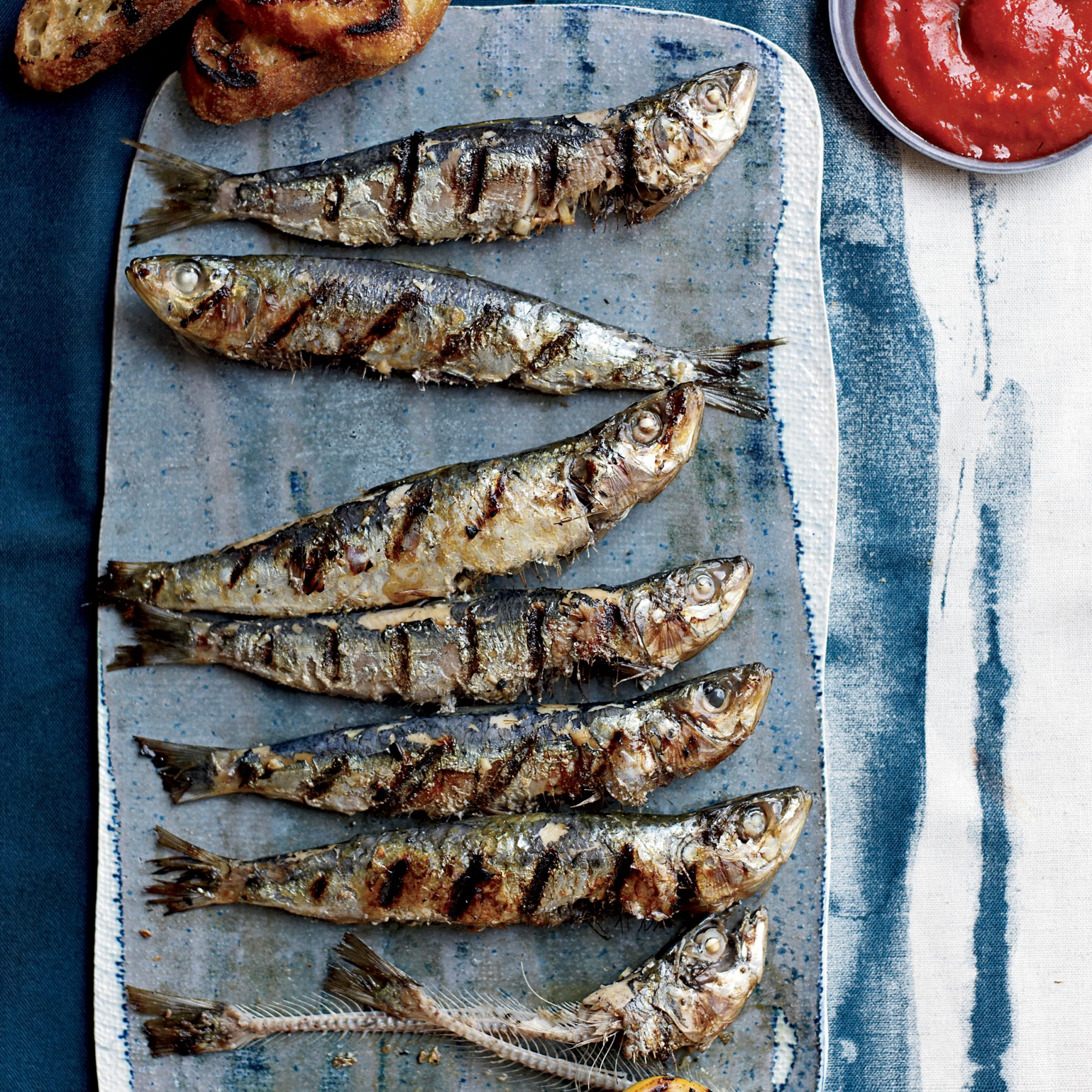 201109-r-grilled-sardines-with-piquillo-pepper-sauce.jpg