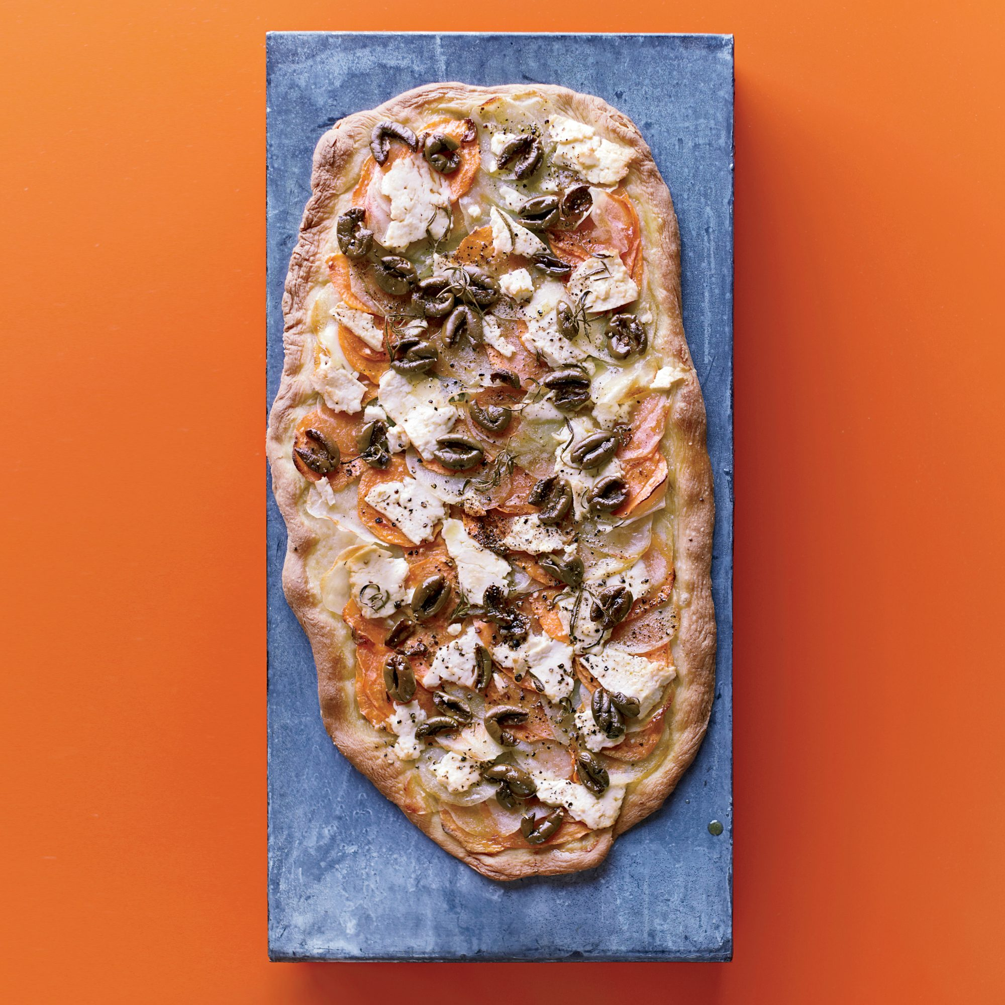 201109-r-two-potato-flatbread-with-olives-and-feta.jpg