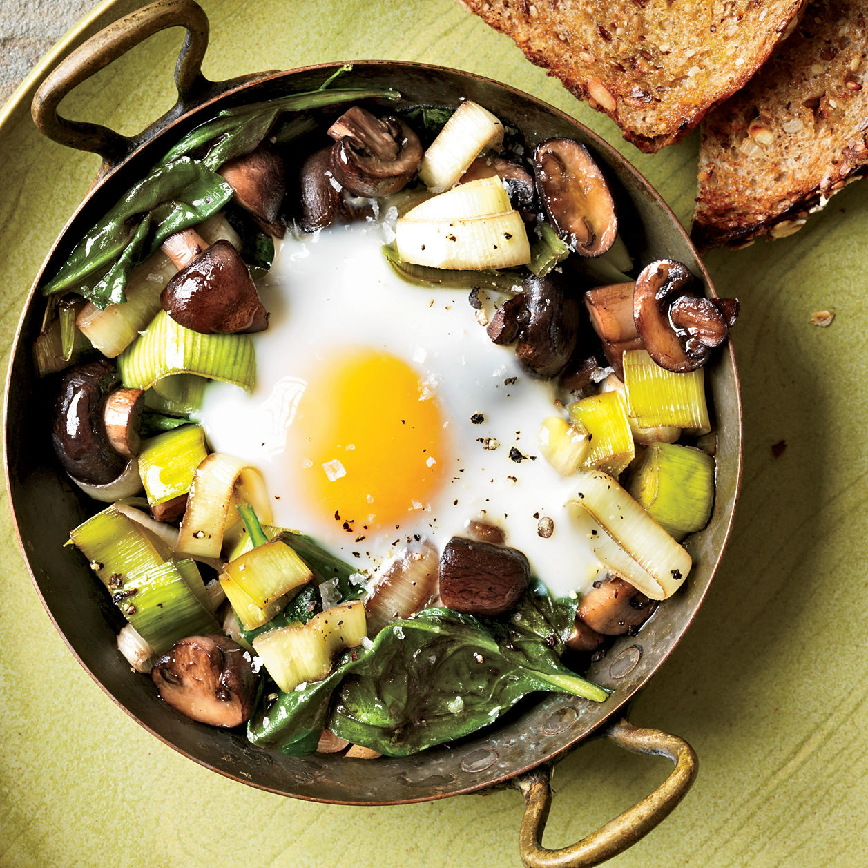 Eggs Baked Over Sautéed Mushrooms and Spinach Recipe