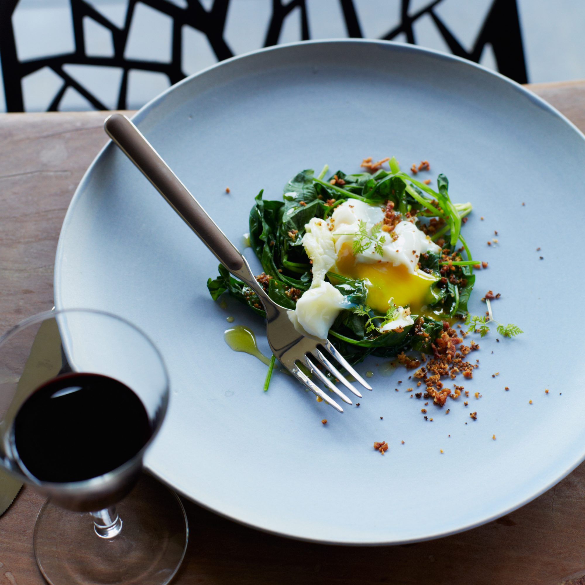 Poached Eggs with Bacon Crumbs and Spinach
