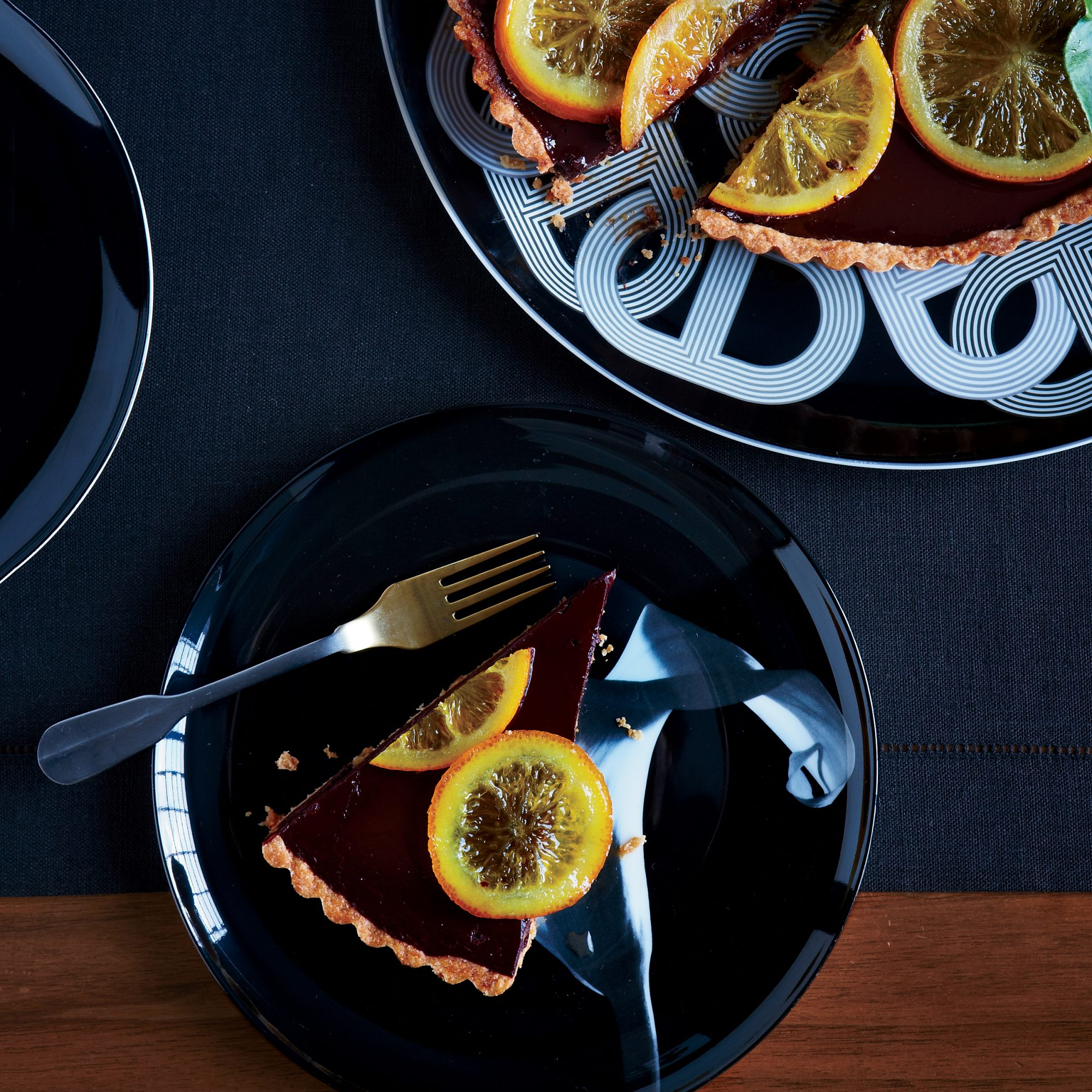 original-201312-r-bittersweet-chocolate-truffle-tart-with-candied-oranges.jpg