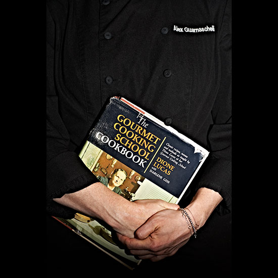 original-201312-HD-treasured-alex-guarnaschelli-holding-cookbook.jpg