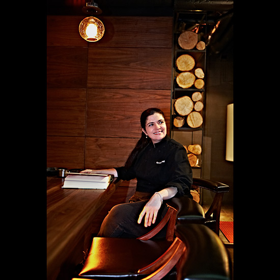 original-201312-HD-treasured-alex-guarnaschelli-portrait-sitting.jpg