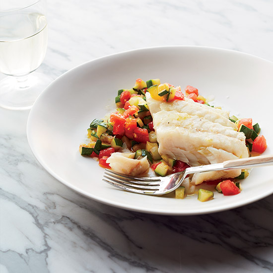 HD-201405-r-olive-oil-poached-hake-on-sauteed-zucchini-with-tomatoes.jpg