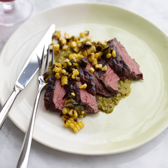In this ingenious 3-ingredient recipe, grilled fresh corn and poblano chile are used in two ways: Half of the mixture gets pureed into a sauce that's served under seared skirt steak and the rest becomes a chunky salsa that's spooned on top. © Con Poulos