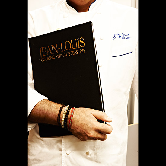 original-201408-HD-treasured-eric-ripert-holding-book.jpg