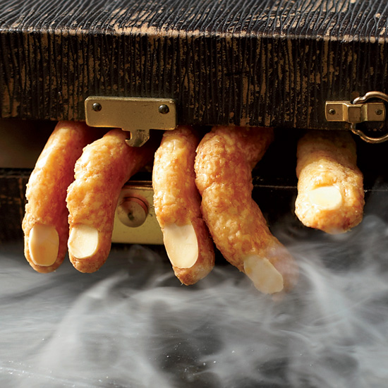 Come Halloween, shape cheesy crackers into creepy witch fingers, pressing a sliced almond into each one to make the nail. // © David Malosh