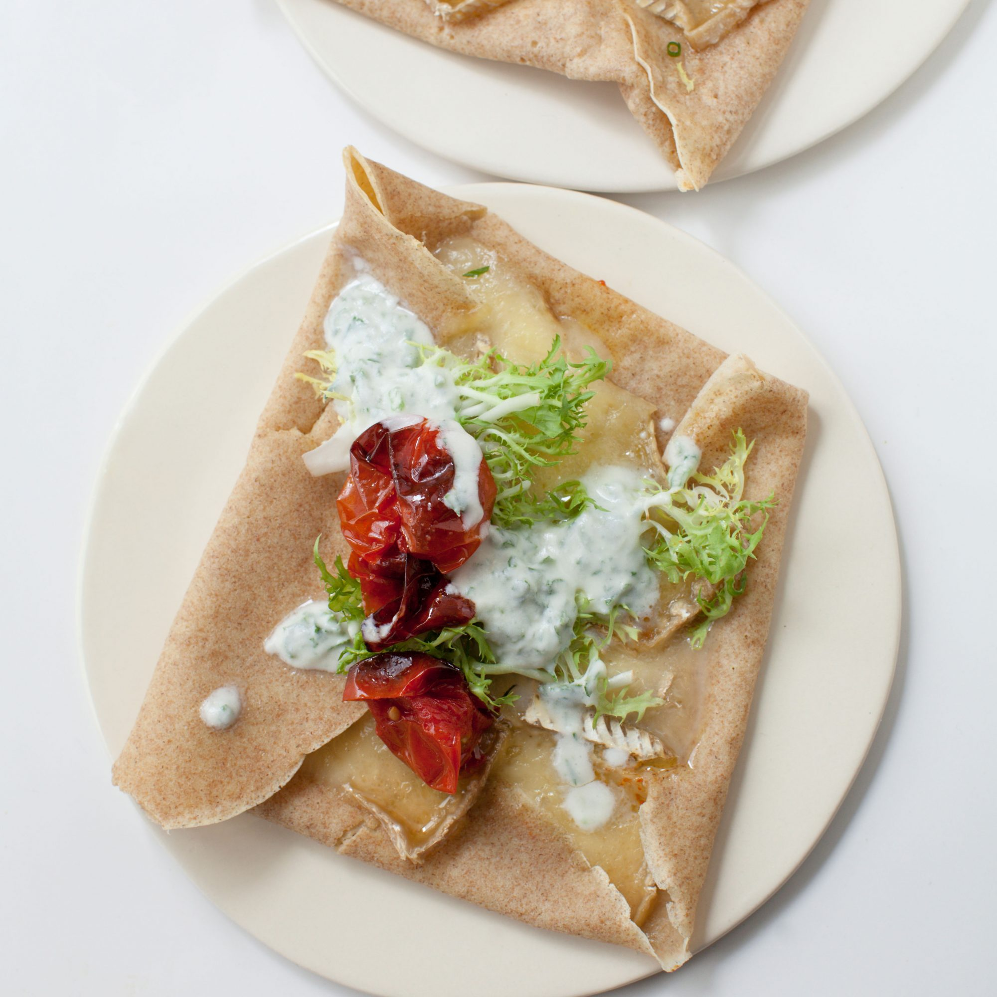 Brie Crêpe Melts with Roasted Tomatoes and Herb-Buttermilk Sauce