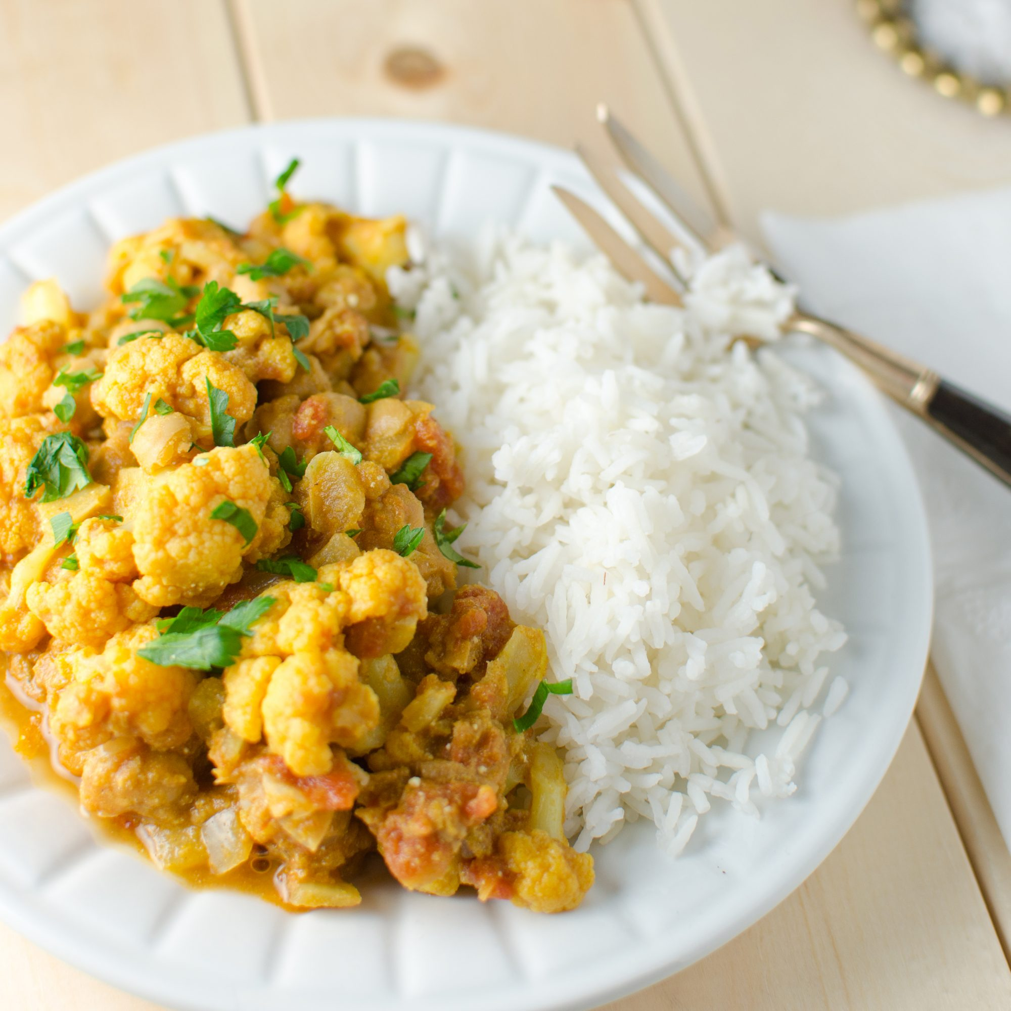 indian chickpea and cauliflower curry recipe kristen stevens food wine. Black Bedroom Furniture Sets. Home Design Ideas