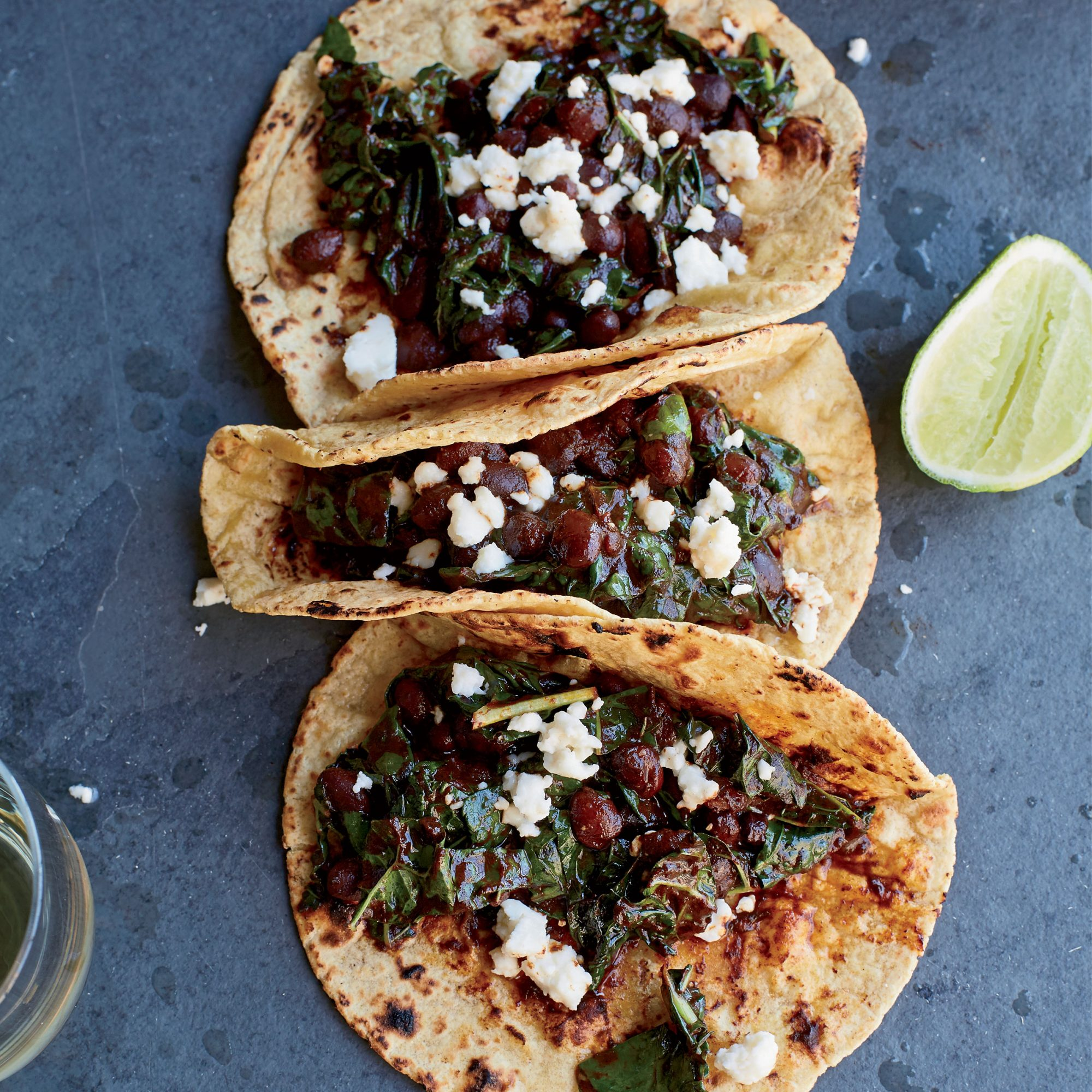 Kale Black Bean and Red Chile Tacos with Queso Fresco