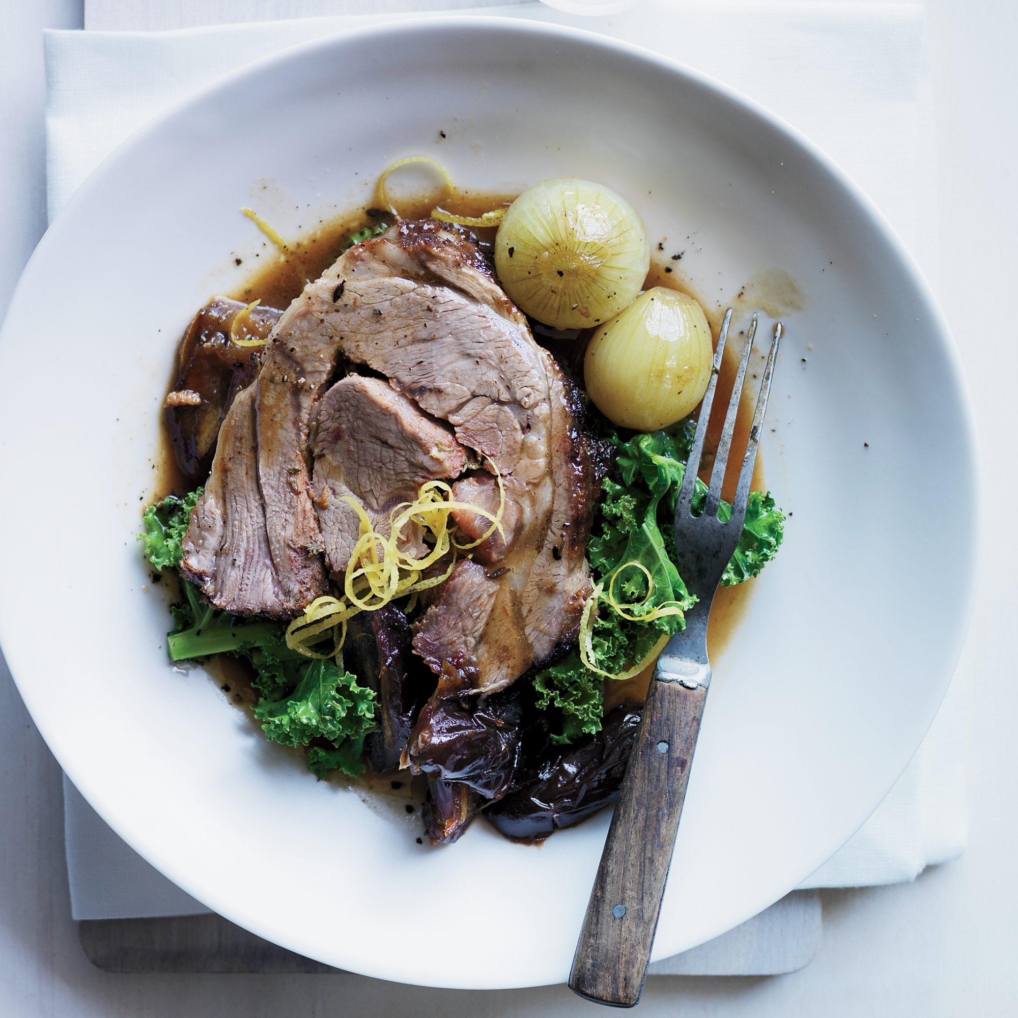Slow-Cooked Lamb with Cipollini Dates Kale & Almonds