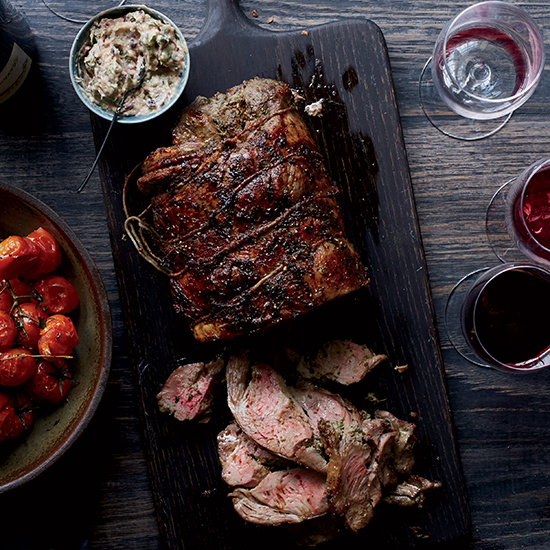 Herbed Leg of Lamb with Olive Butter and Roasted Tomatoes