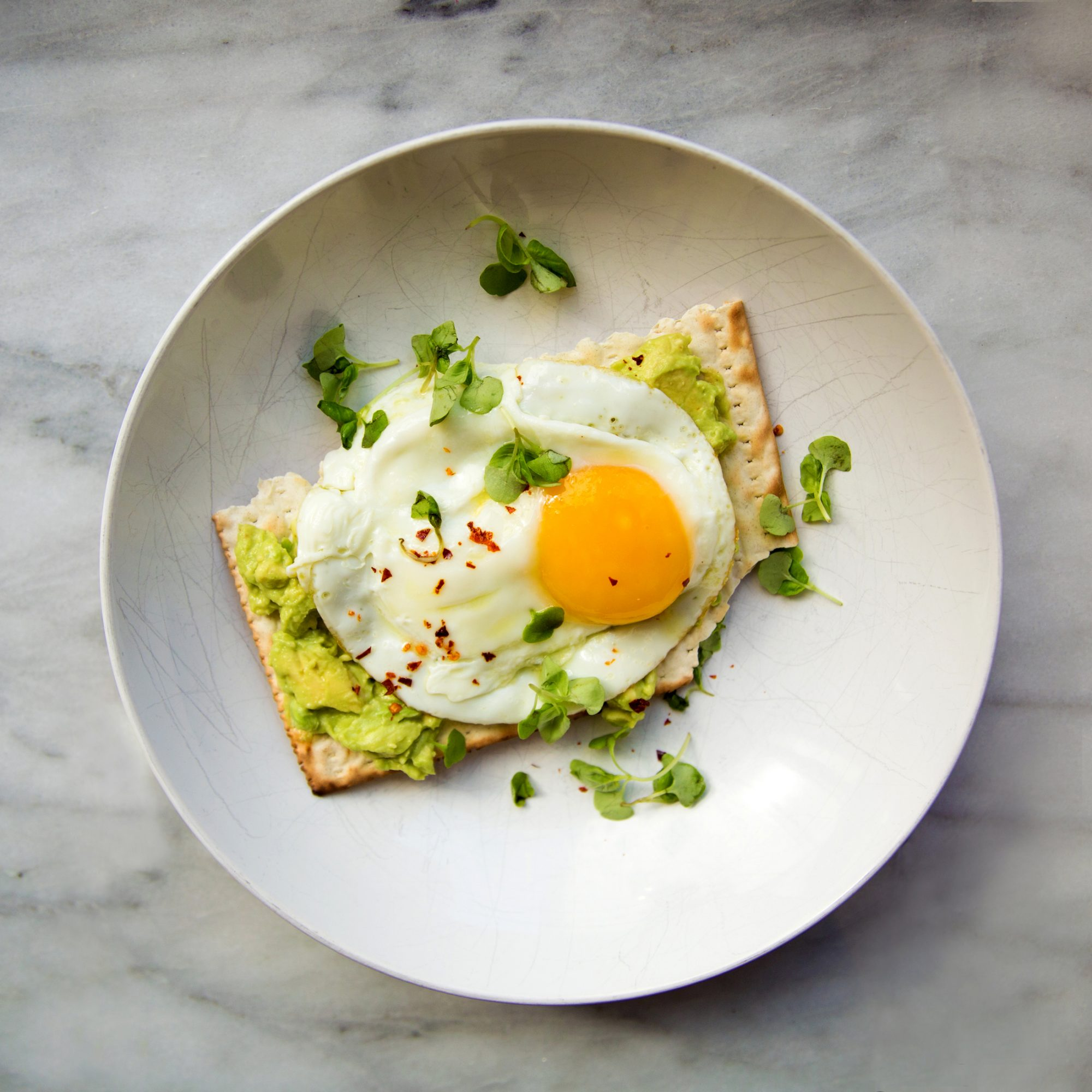 Matzo Avocado Crostini with Fried Eggs