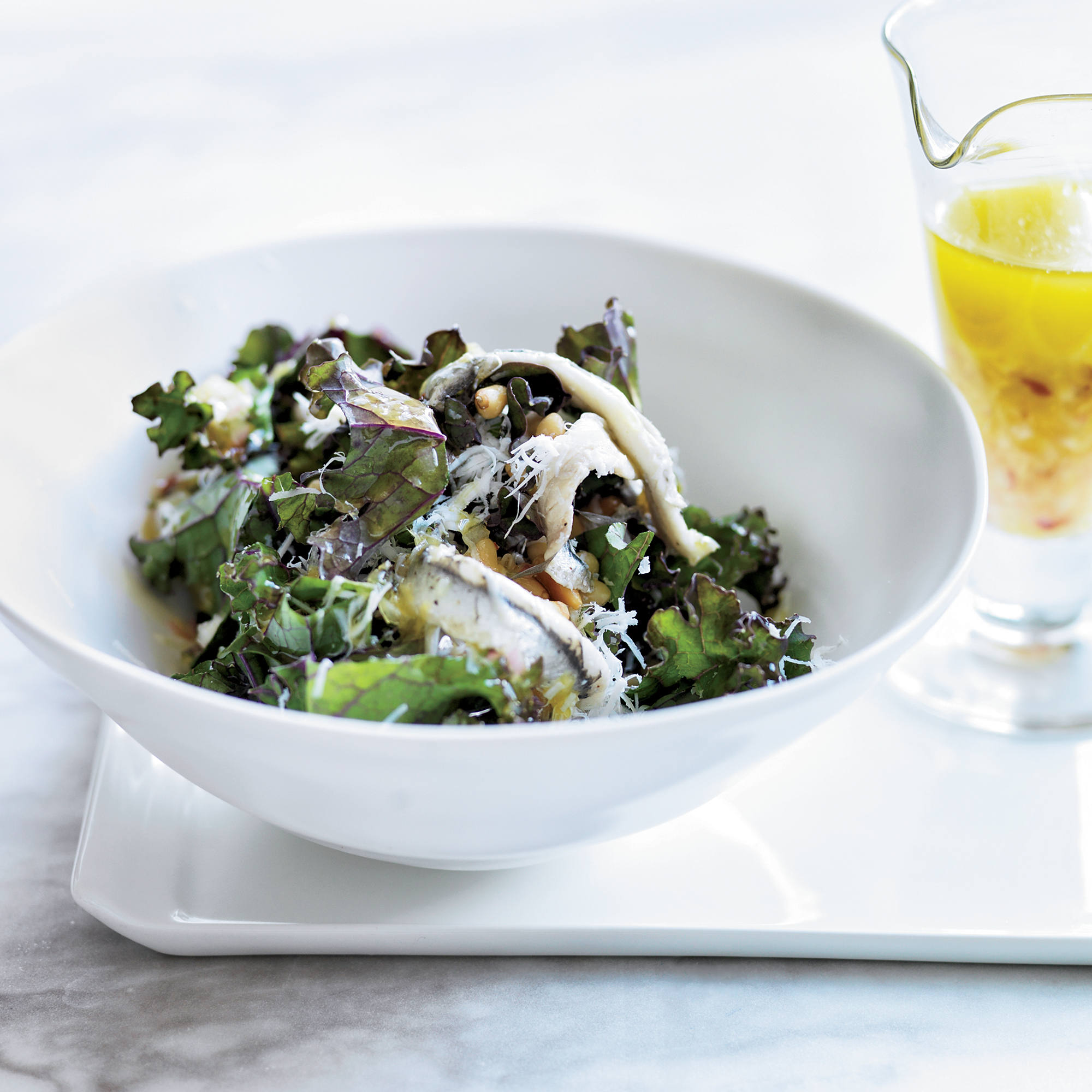 Kale Salad with Ricotta Salata, Pine Nuts & Anchovies