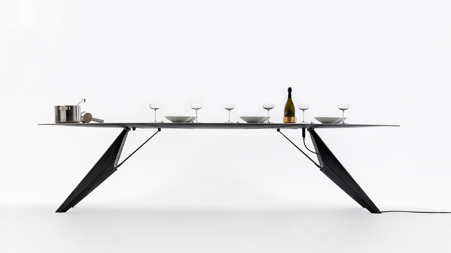 This Futuristic Table Will Keep Food Warm, Cool Down Drinks and Charge Your Phone