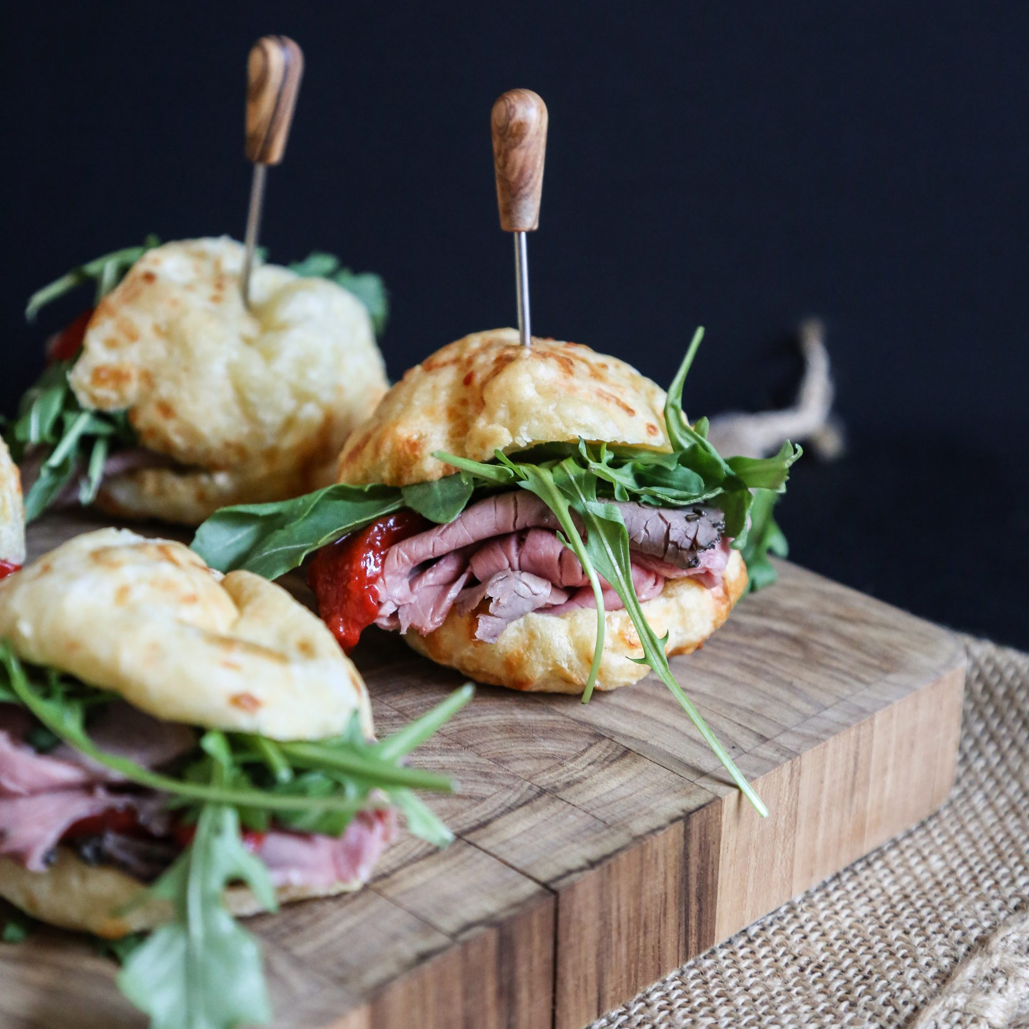 Brazilian Cheese Bread Sliders with Roast Beef, Red Peppers, and Arugula
