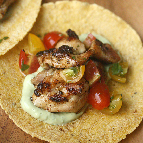 Spiced Chicken Tacos with Cherry Tomatoes and Avocado Crema