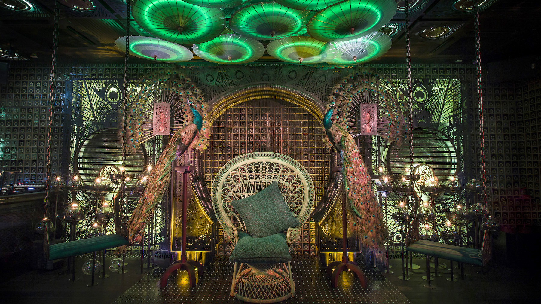 This Luxe Hong Kong Bar Features Peacock Feather Art