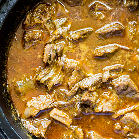 """Goat stew with mild Kashmiri chiles in the Thar Desert. So elegant—a favorite of rajahs and Rabari tribal herders."""