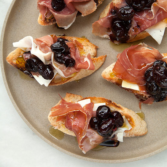 Crostini with Stewed Grapes, Prosciutto and Ricotta Salata