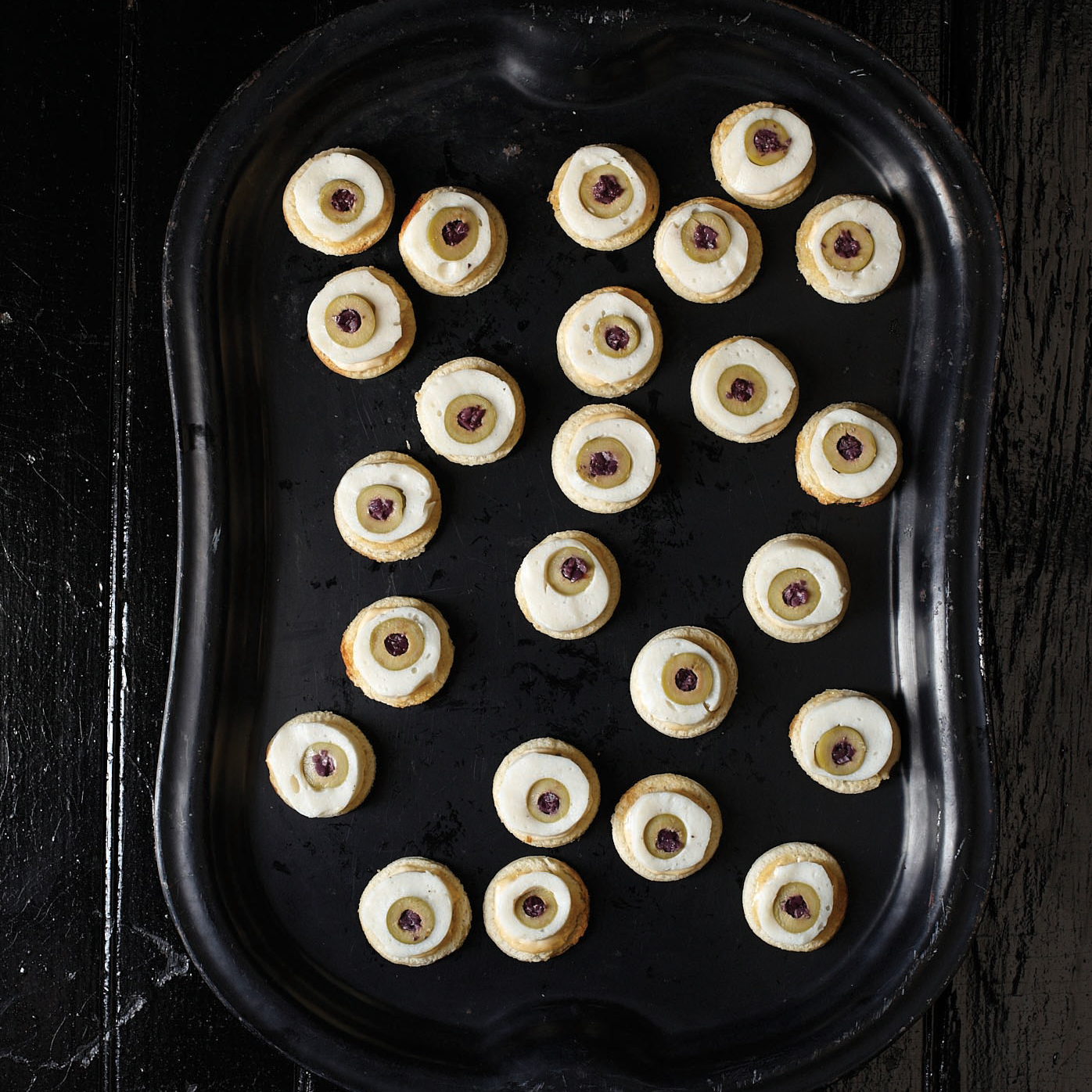 201110-r-scallop-and-olive-eyeball-canapes.jpg