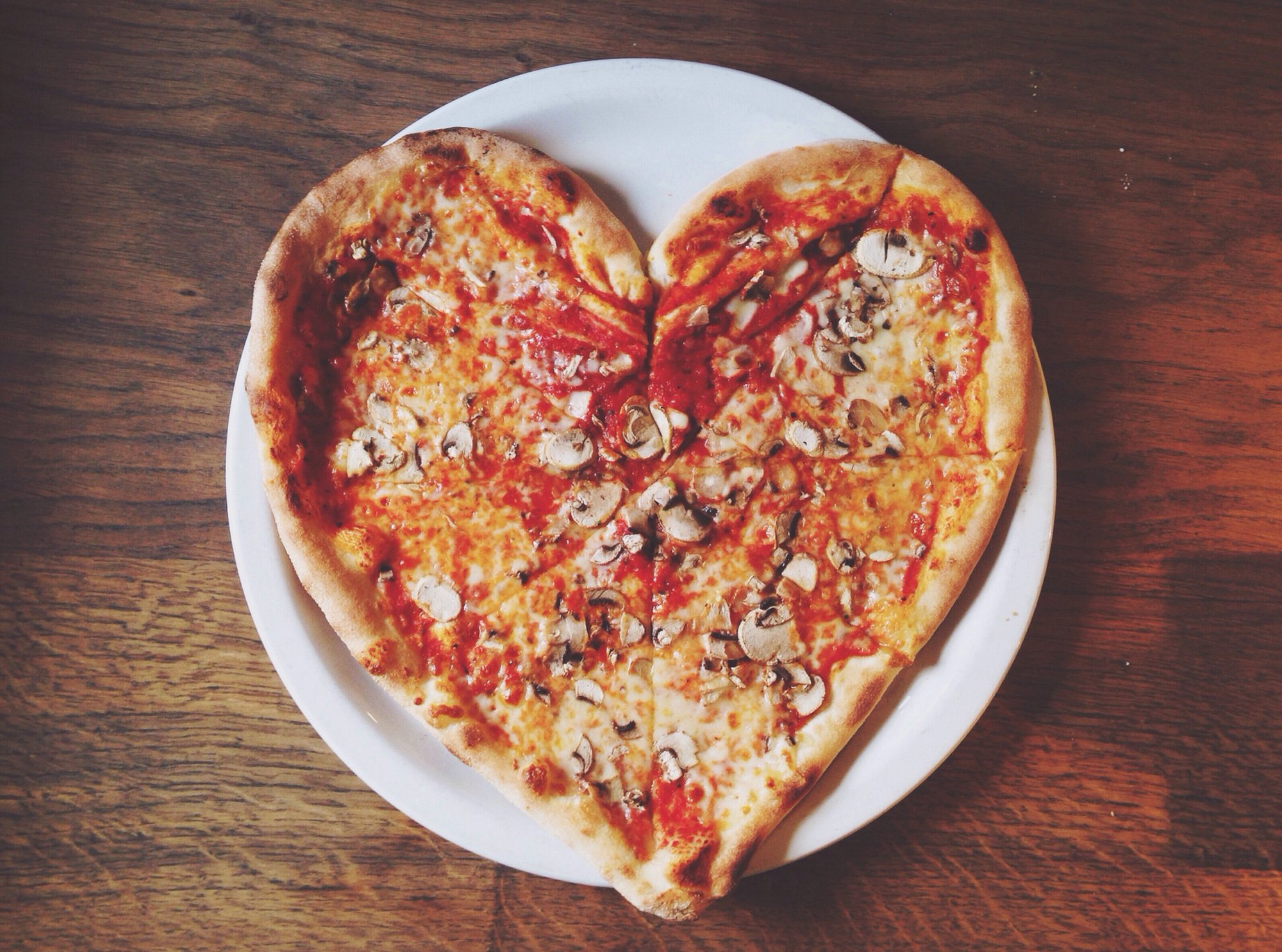 Close-up overhead view of heart shape pizza