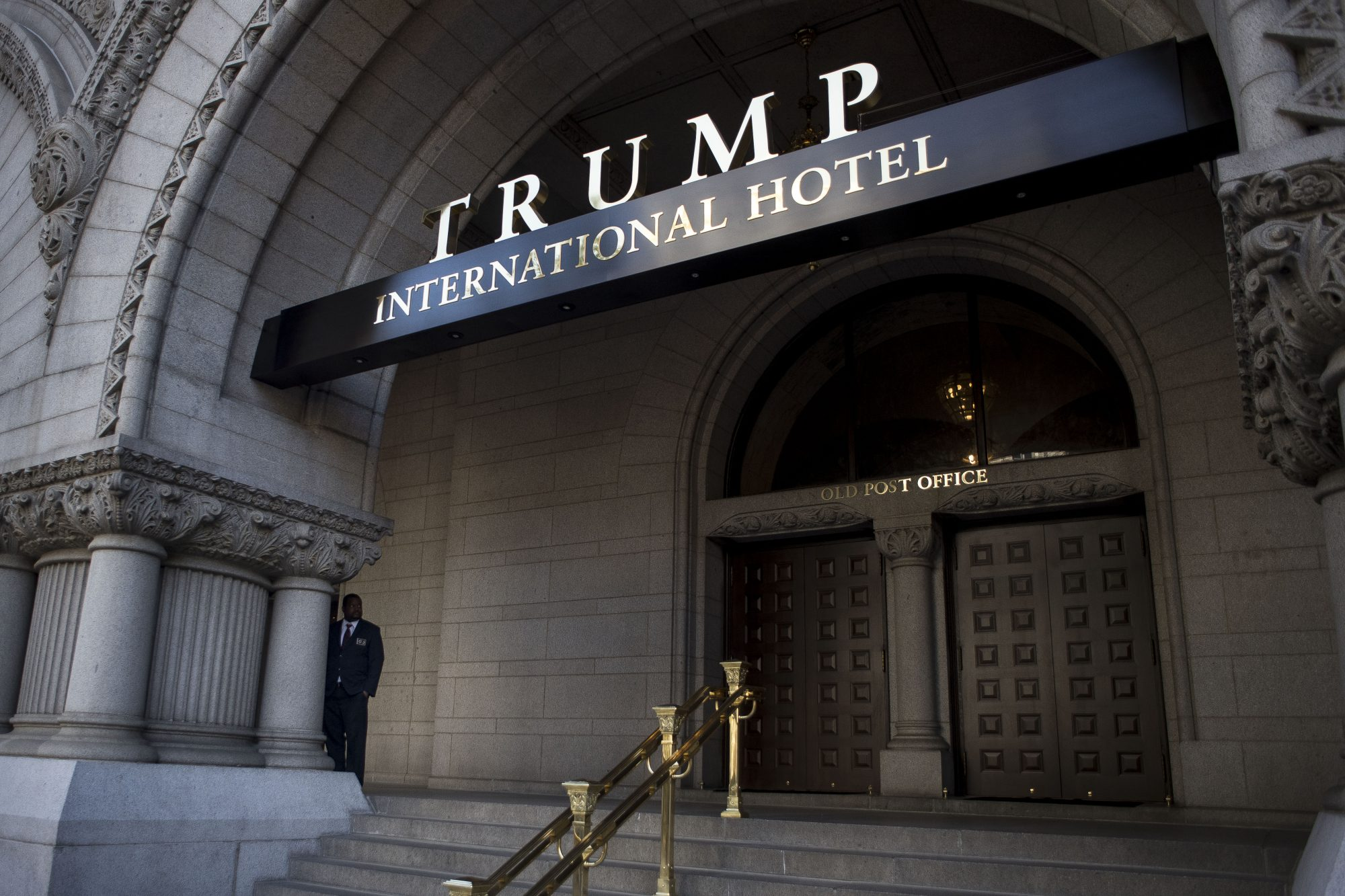 Anti-Trump Activists Protest Outside Of Trump International Hotel Opening Ceremony