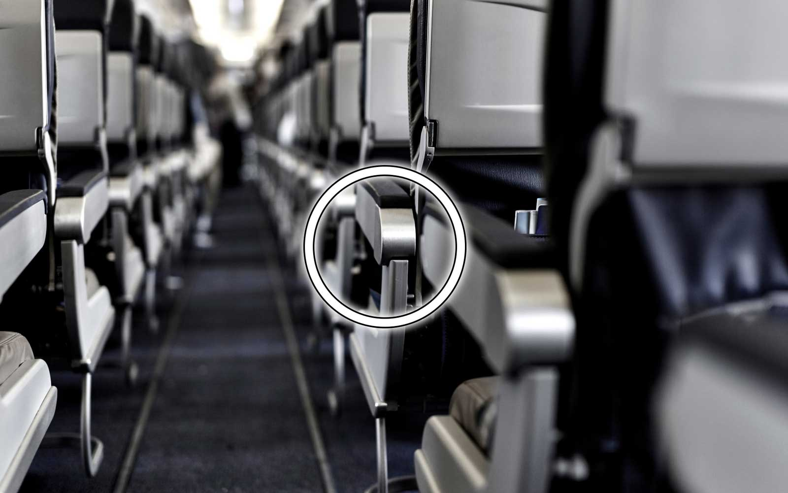 There's a secret button on your airplane seat that will instantly give you more room